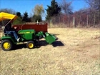 John Deere 318 with Buford Bucket.wmv